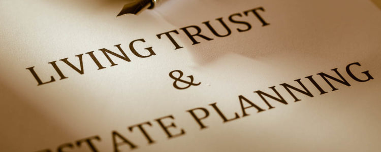 pen lying on a piece of paper that states living trust and estate planning